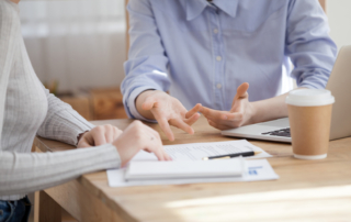 Close up hands of women sitting at the desk office stock photo